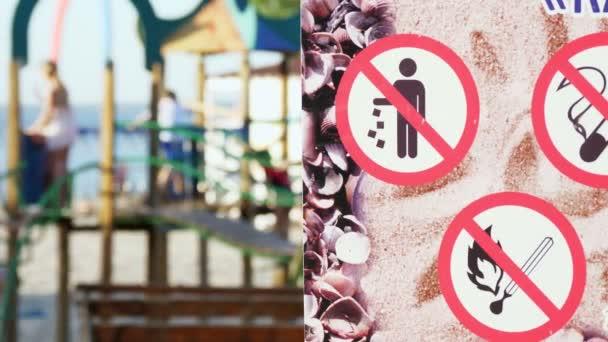 Nahaufnahme, Verbotsschilder auf dem Plakat, wie - nicht rauchen, nicht verschmutzen, nicht anzünden. auf dem Hintergrund des Spielplatzes.