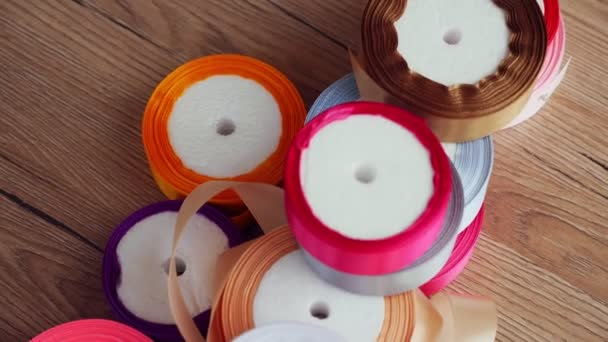 gift wrapping ribbons. multicolored silk ribbons, ribbon reels for packaging, gift decoration. sewing accessories, supplies