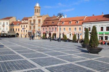 Europe, Romania, Brasov, Council Square, Piata Sfatului, colorful buildings line the square.