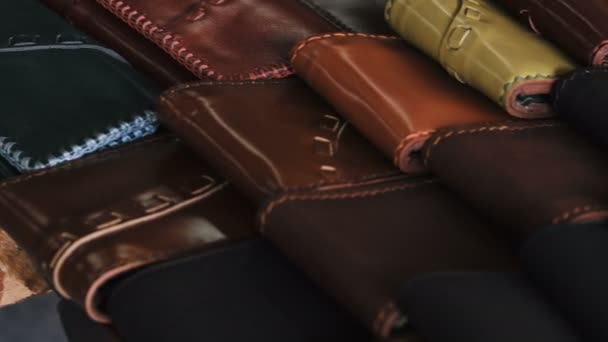 Handmade leather wallets for sale in the family shop.