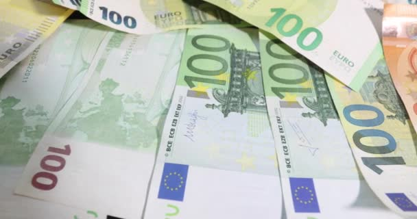 Stack of euro banknotes isolated on a black table.. Financial crisis. Purchasing power of money. money laundering