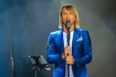 POLTAVA, UKRAINE - 9 JUNE 2018: Ukrainian singer Oleg Vinnik during his performance on stage at Oleksiy Butovsky Vorskla Stadium