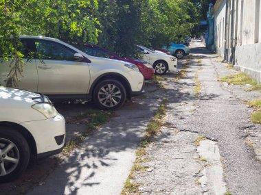Car Parking on the broken sidewalk in Chisinau.