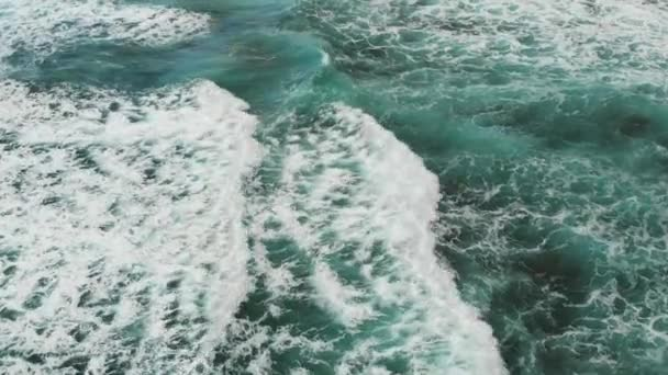 Top view of the Atlantic Ocean, small waves create sea foam near the beach