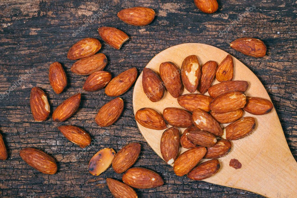 roasted almond nut decoration on wooden table