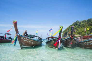 traditional wooden longtrail boat for tourist at Maya bay in Phi phi island Andaman sea most popular chillout destination in summer Krabi ocean Thailand travel - Krabi Thailand 20 February 2017.