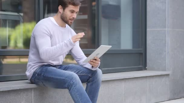 Online Video Chat on Tablet by Handsome Man Sitting Outside Office
