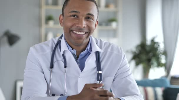 Smiling Positive African-American Doctor At Work Looking at Camera
