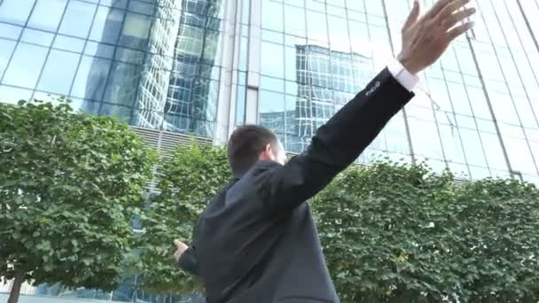 Businessman Celebrating Success Outside Office