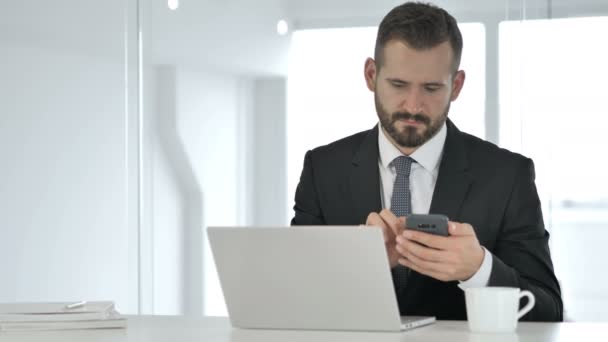 Businessman Using Smartphone, Online Browsing