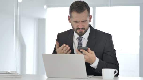 Angry Businessman Yelling on Phone, Financial Loss
