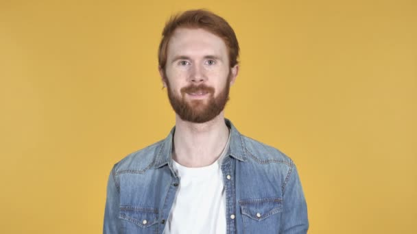 Smiling Redhead Man Isolated on Yellow Background