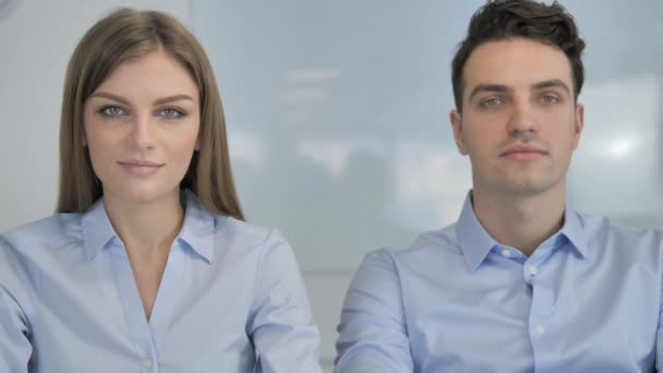 Young Business People Looking at Camera in Office, Colleagues