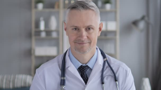 Portrait of Smiling Positive Doctor with Grey Hairs