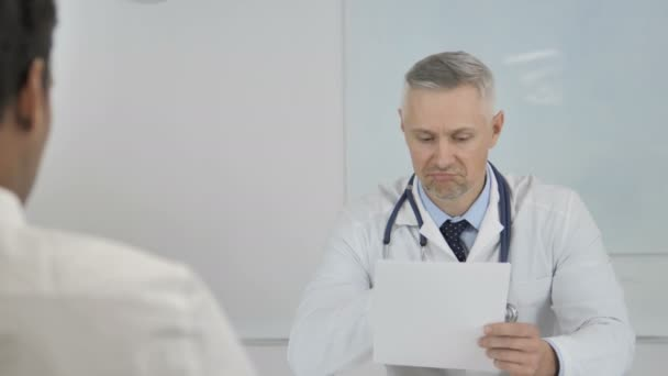 Grey Hair Senior Doctor Giving Prescription to Patient after Discussing Results