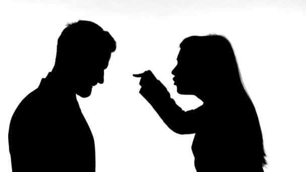 Silhouette of Woman Fighting with Man Against White Background