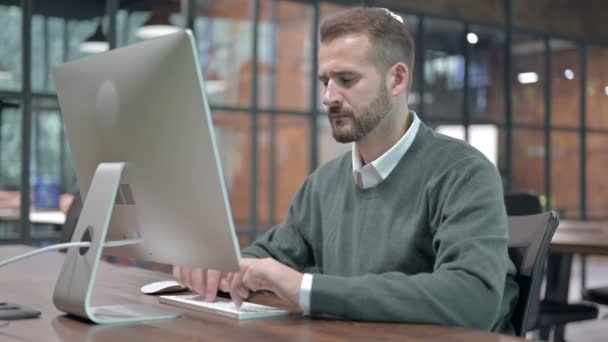 Tired Man having Back Pain while Working on Desktop