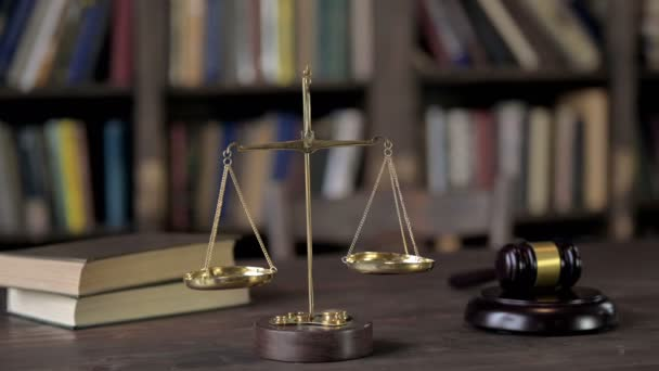 Gavel and Balance Scale on Judge Wooden Table