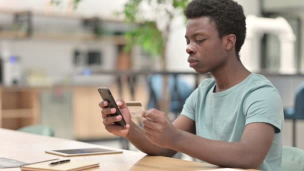 Online Shopping on Smartphone by Young African Man, Online Payment