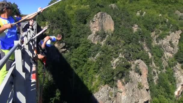 Bungee jumpers 230 feet bridge jump