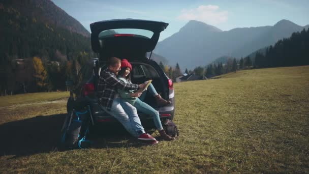 Pretty lovers exploring the local nature. Cute hipster couple of young millennials on their roadtrip after long quarantine self isolation. Social distancing together. Travelling by car after pandemic