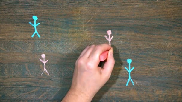 Closeup of hand draws on a wooden board. Human figures. social network