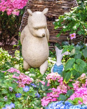 Sculpture of Disney cartoon characters Winnie the Pooh and Piglet. Installation in the garden of greenhouses Flower dome, Singapore