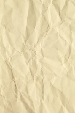 Paper beige color aged and wrinkled. Background of brown color with kinks and fraying.