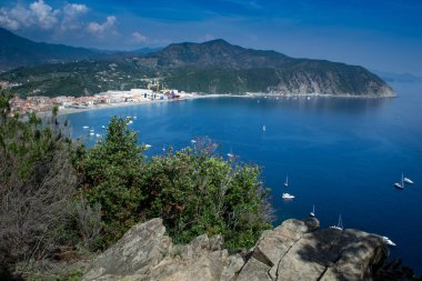 SESTRI LEVANTE, GENOA, ITALY - view of Riva Trigoso and promontory of Punta Baffe from the  Punta Manara, the sea in the inlet, Liguria, Italy.