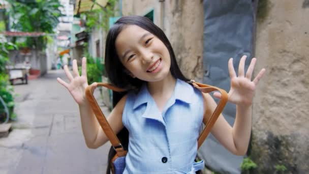 Portrait of asian girl smiling at camera on street of Bangkok, Thailand
