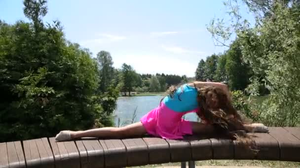 girl gymnast doing exercises in the park