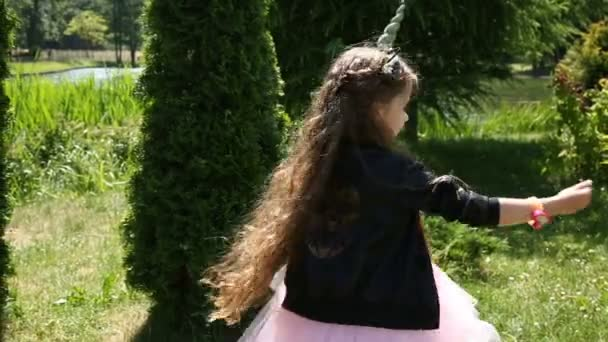 Little girl unicorn blows magic pollen
