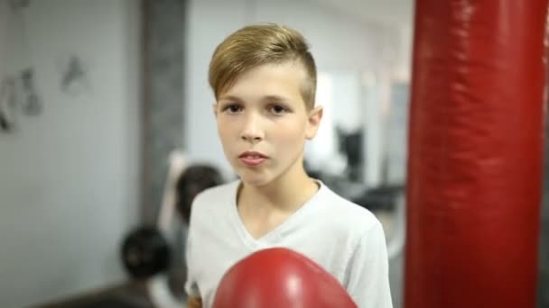 Boy in red boxing gloves beats