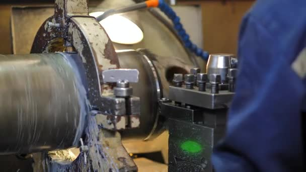 Turning lathe in action.Facing operation of a brass blank on turning machine with cutting tool.Old turning lathe machine in turning workshop.