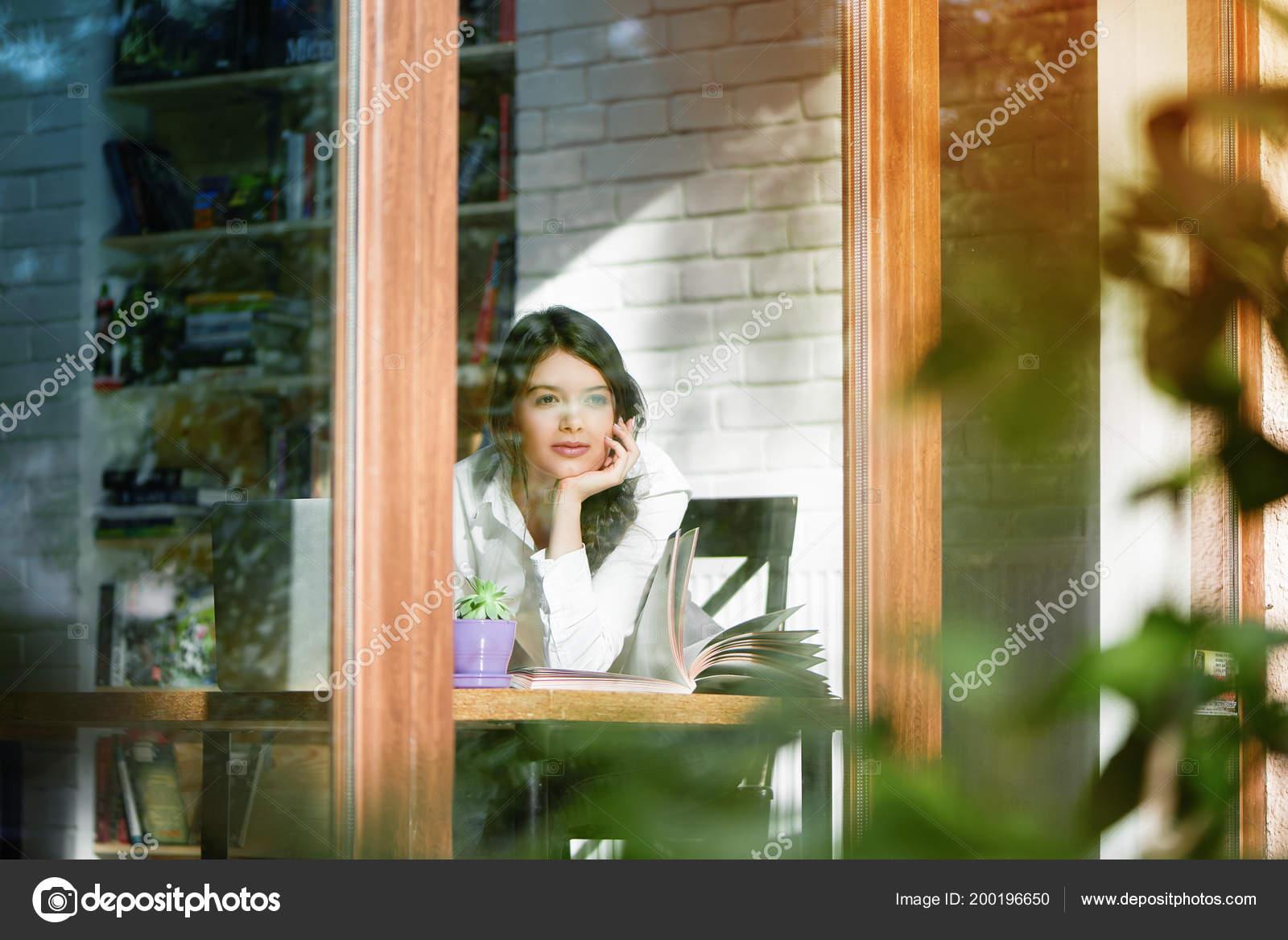 Horizontal Photo Of Girl Looking Outside Throw Window Glass Stock
