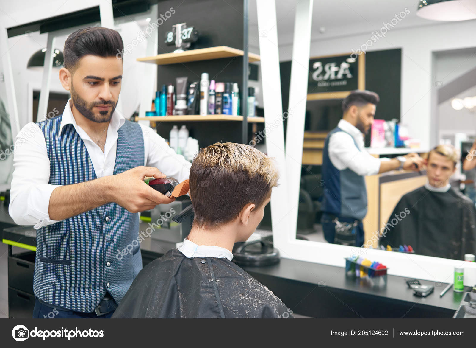 Doing New Modern Hairstyle For Young Man In Barber Shop Stock