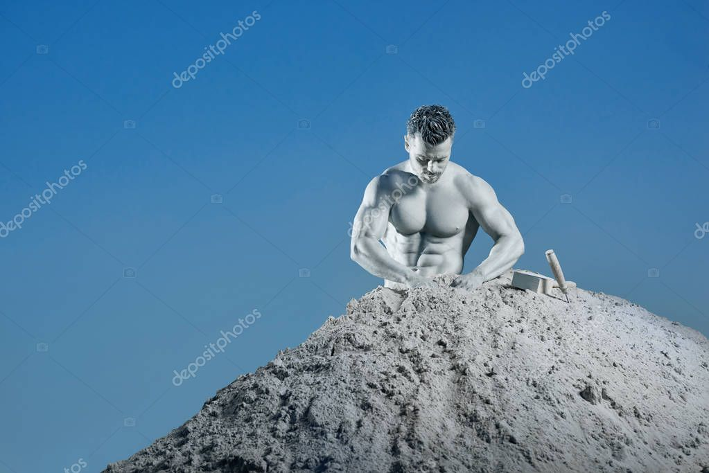 Handsome silver skin man in mountain creating his body.