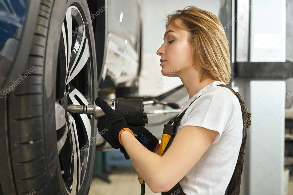 Female Mechanic With Tire Iron Stock Of Beauty Porndig 1