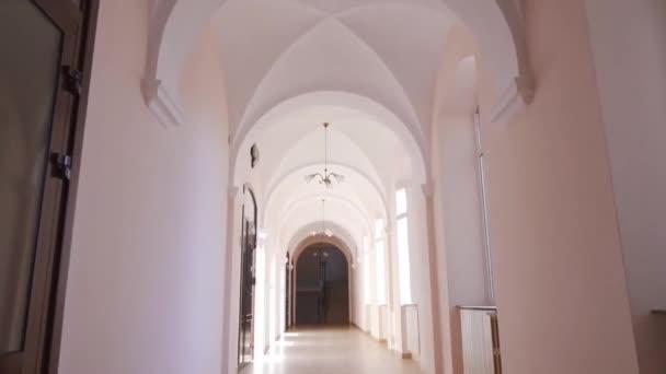 Front view of light corridor with big windows in school