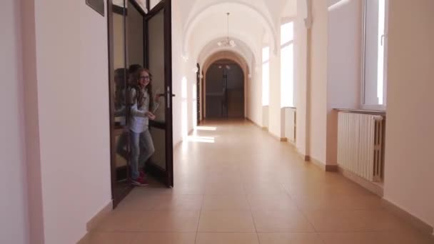 Happy pupils running through corridor after lessons