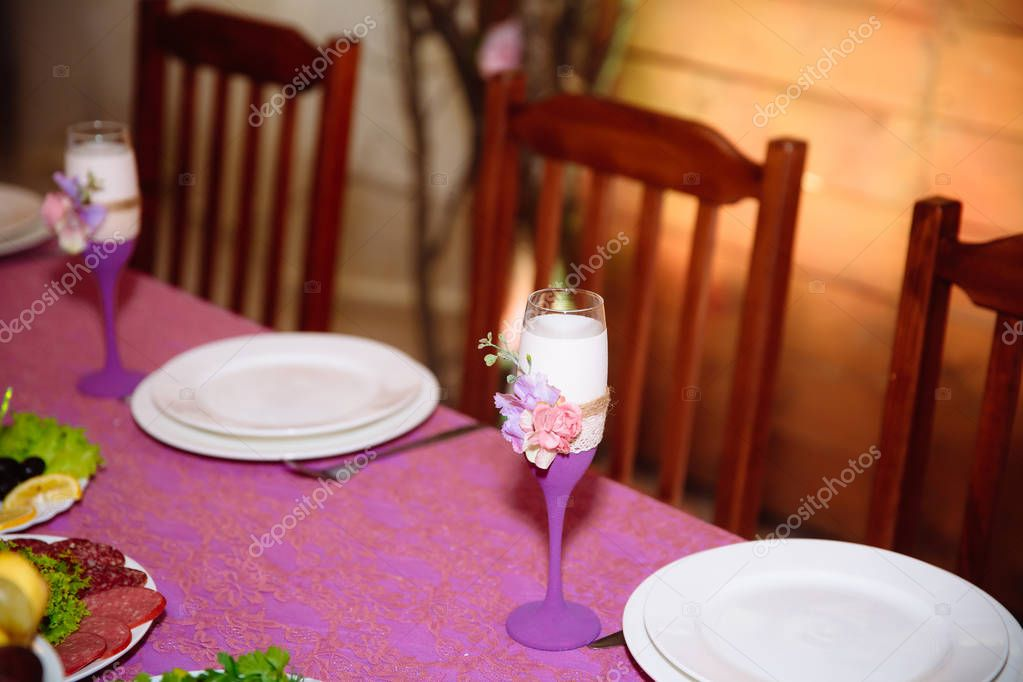 Beautiful decorated wedding restaurant for marriage. Colorful decoration for celebration. Beauty bridal interior. Concept of style of banquet hall