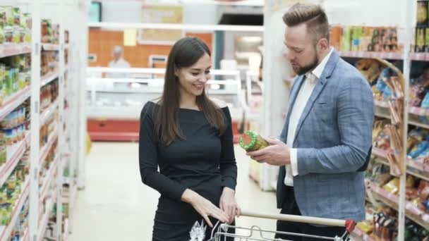Beautiful couple choose products in supermarket