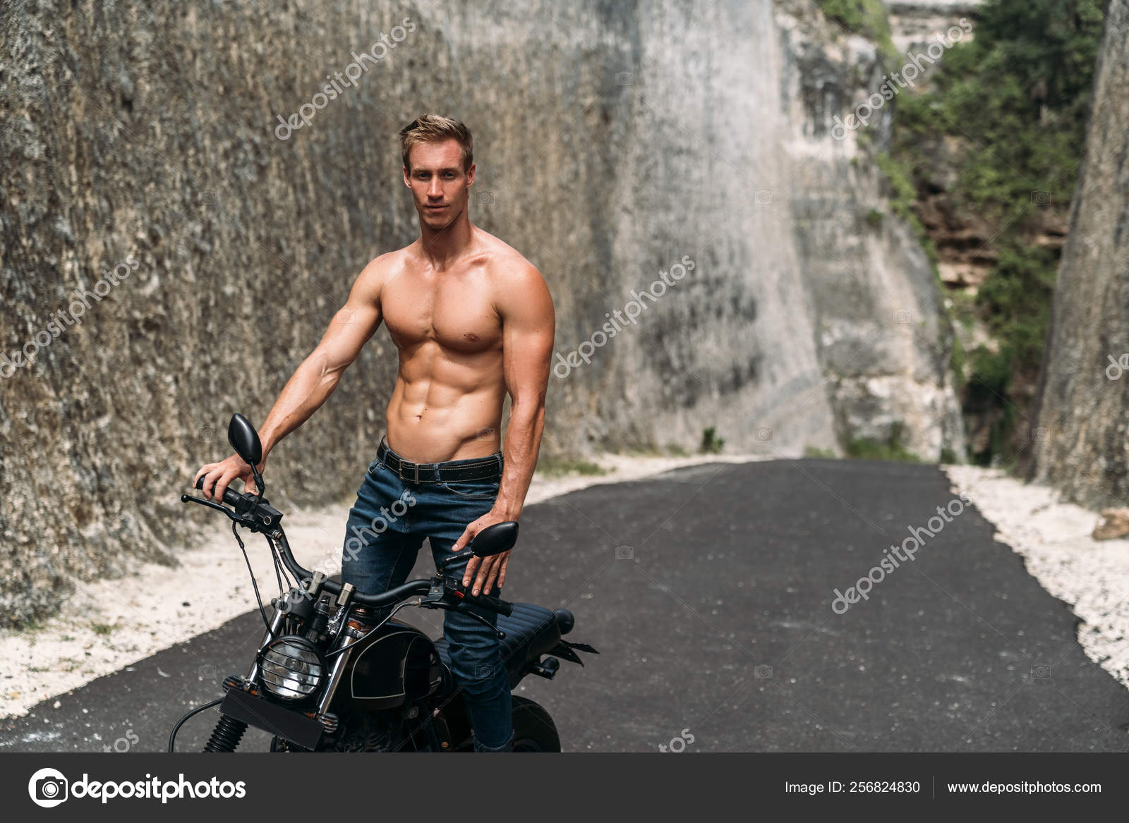 Sexy Muscular Man Riding On Motorbike On The Road Between The Rocks Stock Photo C Rmano Mail Ru 256824830