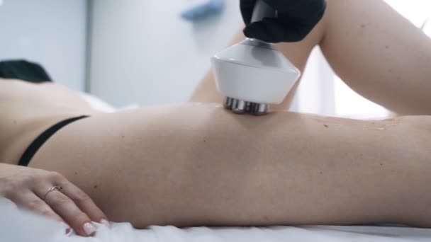 Close up, part of woman body during rf lifting procedure in beauty clinic, slow motion