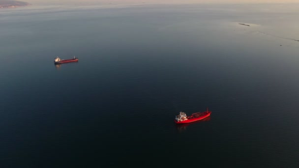 Top aerial view of the large crude oil tanker ship sailing in sea to loading port