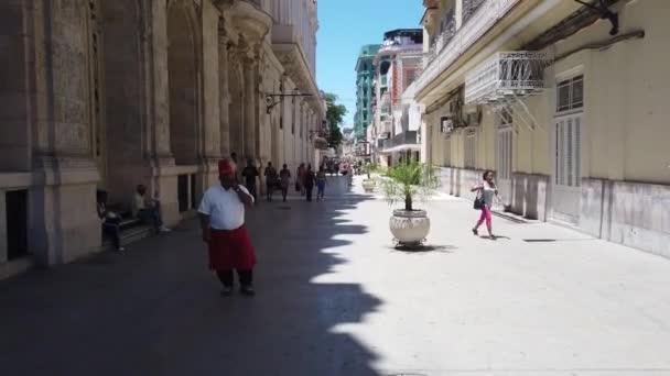 HAVANA, CUBA - APRIL 2019: Havana is an iconic popular tourist destination. Old streets of Havana. Classic American Vintage Retro Cuban Cars driving on the street of Havana city, Cuba.