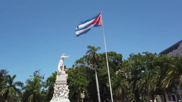Flag of Cuba is developing in the wind. Cuba flag hanging on the building
