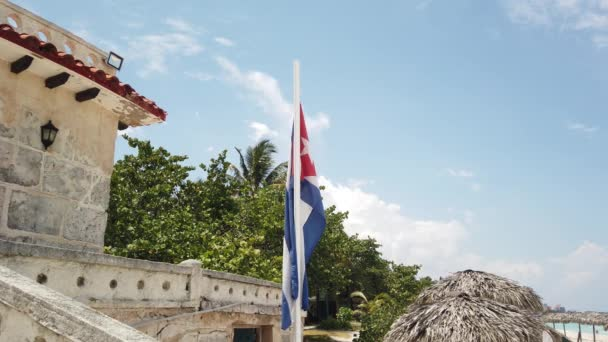 Cuban flag on the beach, flying in the wind on background of ocean. Cuba, Varadero.