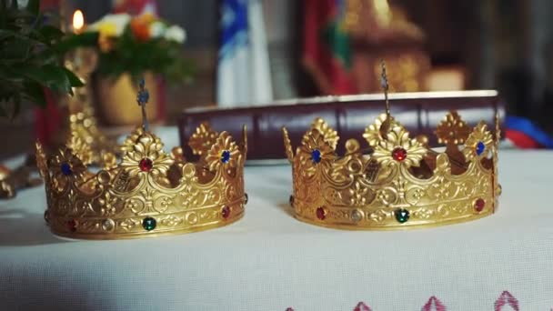 Gold crowns are on the altar. Attributes of priest