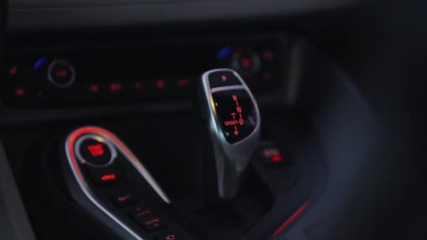 Shift knob of automatic gearbox in car interior